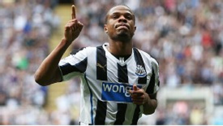 Loic Remy celebrates his second against Hull City, but the Tigers would roar back once more.