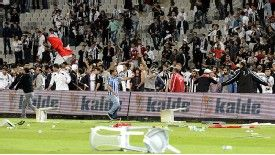 Besiktas and Galatasaray fans stormed the pitch and hurled objects towards the end of Sunday's match.