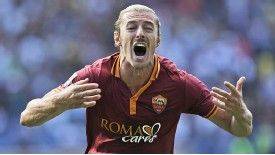 Federico Balzaretti celebrates after giving Roma the lead just after the hour.
