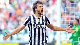 Fernando Llorente celebrates after netting the winner against Hellas Verona in first-half stoppage time.