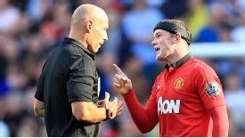 Howard Webb and Wayne Rooney exchange words at the Etihad Stadium.