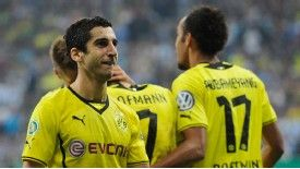 Henrikh Mkhitaryan celebrates after netting Dortmund's second in the victory over 1860 Munich.