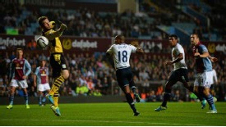 Jermain Defoe puts Tottenham into the lead at Villa Park.