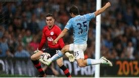 Stevan Jovetic fires home City's third goal in the thrashing of Wigan.