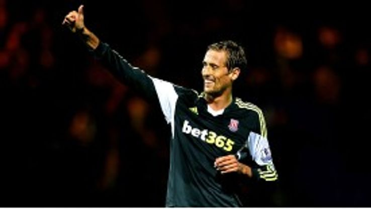 Peter Crouch celebrates after scoring against Tranmere.