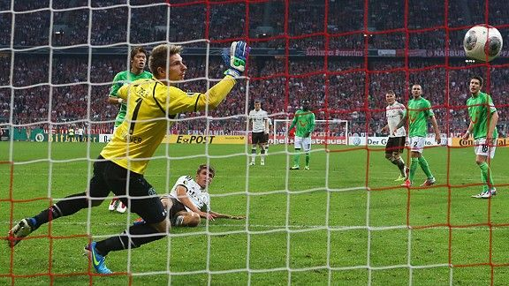 Thomas Muller fires home Bayern's third against Hannover.