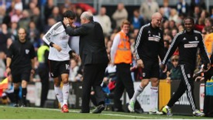Bryan Ruiz celebrates with Fulham boss Martin Jol.