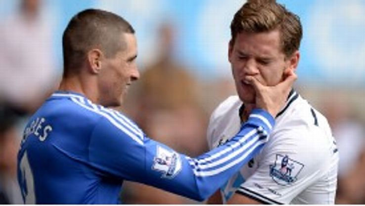 Fernando Torres and Jan Vertonghen clash during the game.