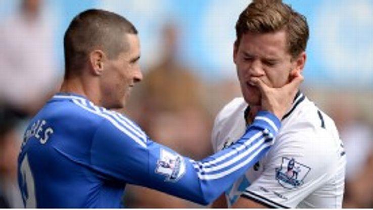Fernando Torres and Jan Vertonghen clash during the game.