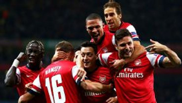 Mesut Ozil is mobbed after giving Arsenal the lead against Napoli.
