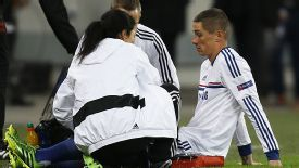 Fernando Torres gets treatment before going off injured at Steaua