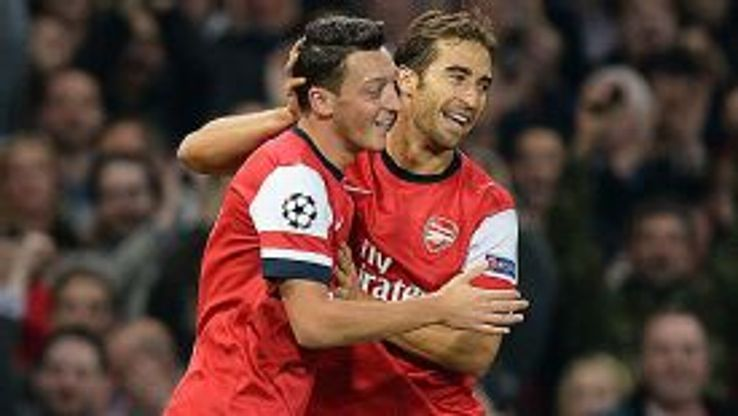 Mathieu Flamini celebrates with goalscorer Mesut Ozil