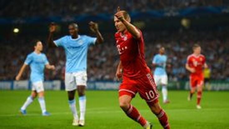 Arjen Robben celebrates the third goal.