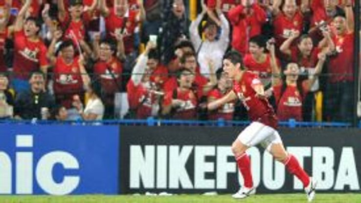 Evergrande's Conca celebrates his goal against Kashiwa Reysol.