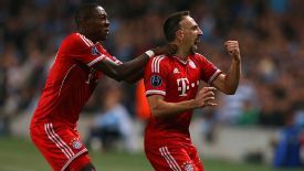 Franck Ribery celebrates scoring his side's first goal of the game with teammate David Alaba