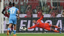 Napoli keeper Pepe Reina saves a penalty by AC Milan's Mario Balotelli.