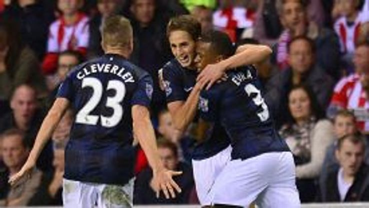 Adnan Januzaj is mobbed by his United teammates after scoring his second of the game.