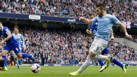 Alvaro Negredo scores for Man City against Everton.