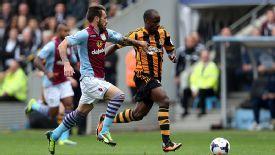 Antonio Luna battles with Sone Aluko during Aston Villa's Premier League game against Hull.