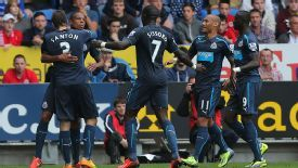 Loic Remy is congratulated by his Newcastle teammates after making it 2-0 against Cardiff.