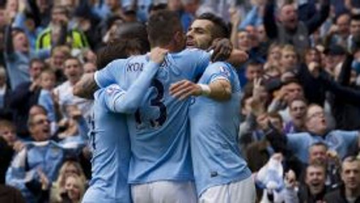 Manchester City players celebrate during their game against Everton.