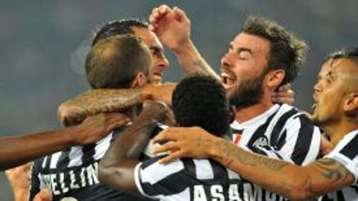 Giorgio Chiellini is mobbed after scoring for Juventus against AC Milan.
