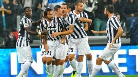 Andrea Pirlo celebrates his goal with his Juventus team-mates.