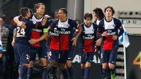 PSG players celebrate their opening goal in the victory over Marseille.