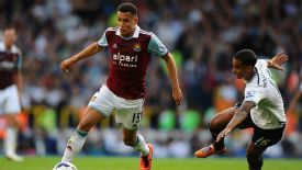Ravel Morrison surges forward for West Ham against Tottenham.