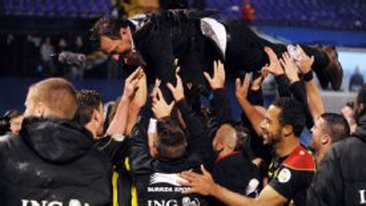 Belgium coach Marc Wilmots was hoisted aloft by his players after they secure World Cup qualification.