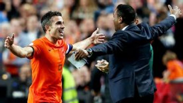Robin van Persie celebrates with Patrick Kluivert after matching his scoring record.