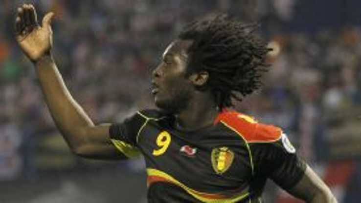 Romelu Lukaku celebrates one of his two goals as Belgium won in Croatia to qualify for the World Cup finals.