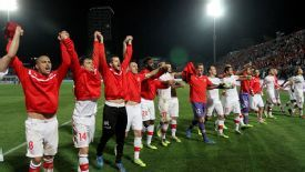 Switzerland players celebrate securing their nation's place in Brazil.