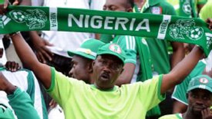 A Nigeria fan shows his support for his side.