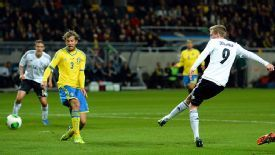 Andre Schuerrle scores Germany's third against Sweden.