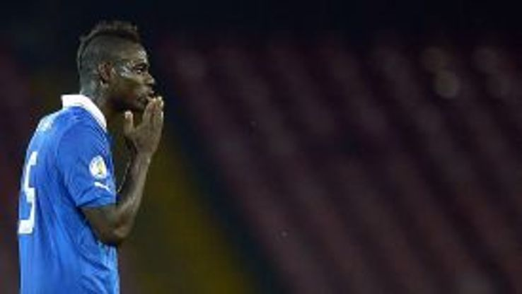 Mario Balotelli celebrates after equalising in the 2-2 draw with Armenia.