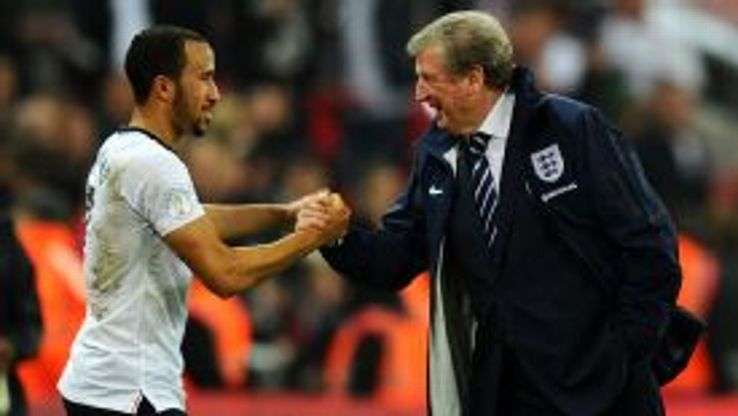 Andros Townsend shakes hands with Roy Hodgson after being substituted in the final minutes of the win over Poland.