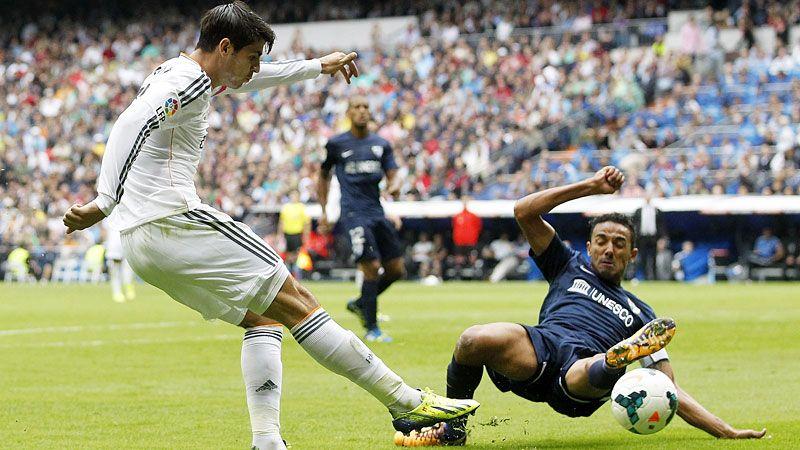 Weligton makes sure Alvaro Morata cannot get a shot in.