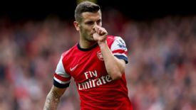Jack Wilshere celebrates after putting Arsenal a goal to the good against Norwich City.