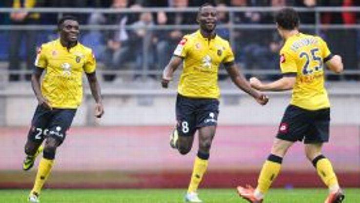 Sochaux celebrate after Joseph Romeric Lopy (c) forced a draw against Monaco.