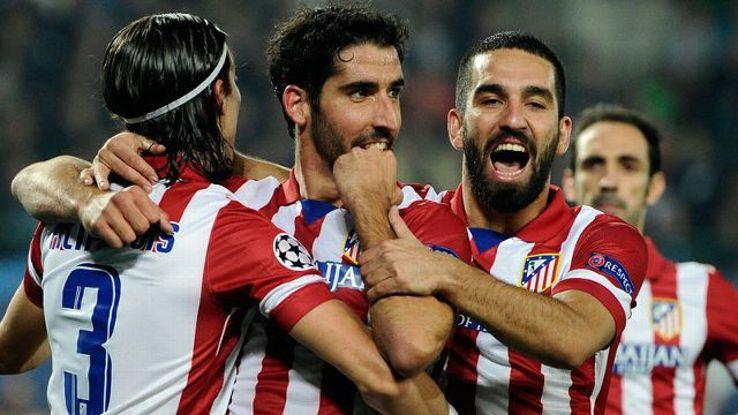 Madrid's Filipe Luis, Raul Garcia and Arda Turan celebrate after scoring