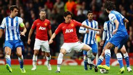 Shinji Kagawa tries to win the ball back for United.