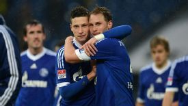 Julian Draxler and Benedikt Hoewedes celebrate March's 2-1 victory in Gelsenkirchen.
