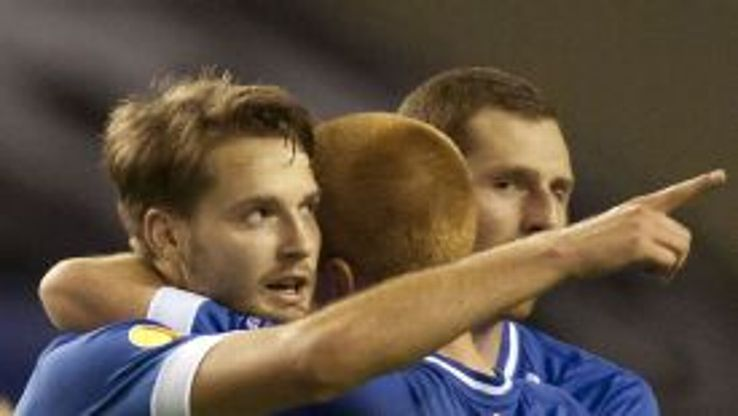 Nick Powell celebrates his equaliser with his Wigan teammates.