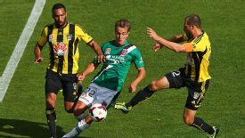 Newcastle Jets' Adam Taggart battles against Paul Ifill and Andrew Durante in the 0-0 draw against the Wellington Phoenix.