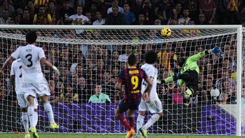 Alexis Sanchez chips the ball into the net for Barcelona.