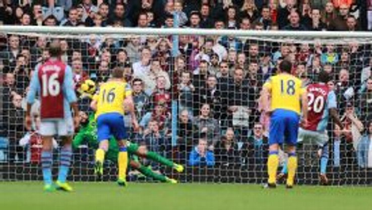 Christian Benteke sees his penalty saved by Everton goalkeeper Tim Howard.