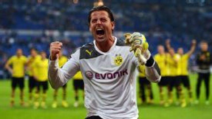 Dortmund goalkeeper Roman Weidenfeller celebrates the victory over Schalke.