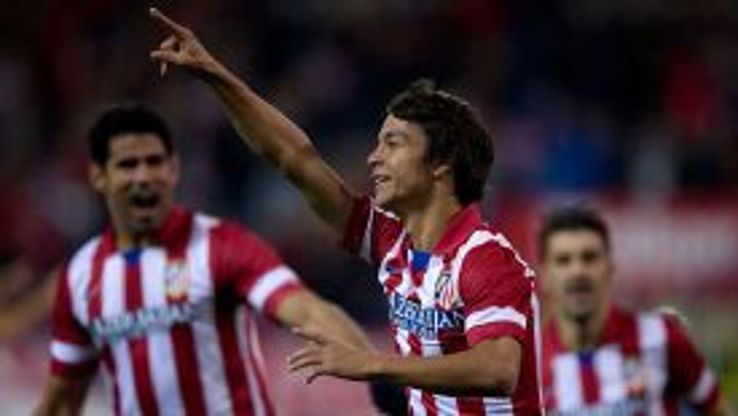 Oliver Torres celebrates after breaking the deadlock for Atletico Madrid.