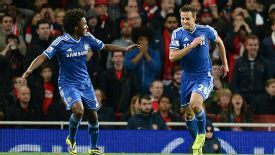 Cesar Azpilicueta and Willian celebrate Chelsea's opening goal at Arsenal.